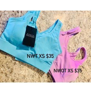 Two XS NVGTN sports bras